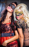 Dance happy young girls under masks on the party — Stock Photo