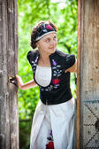The nice Hungarian girl in national clothes — Stock Photo