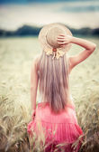 Rural girl in field — Stock Photo
