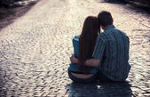 Couple of teenagers sit in street together — Стоковое фото