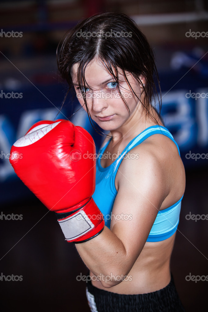 Young and fit female fighter posing in combat poses  — Stock Photo #13276228