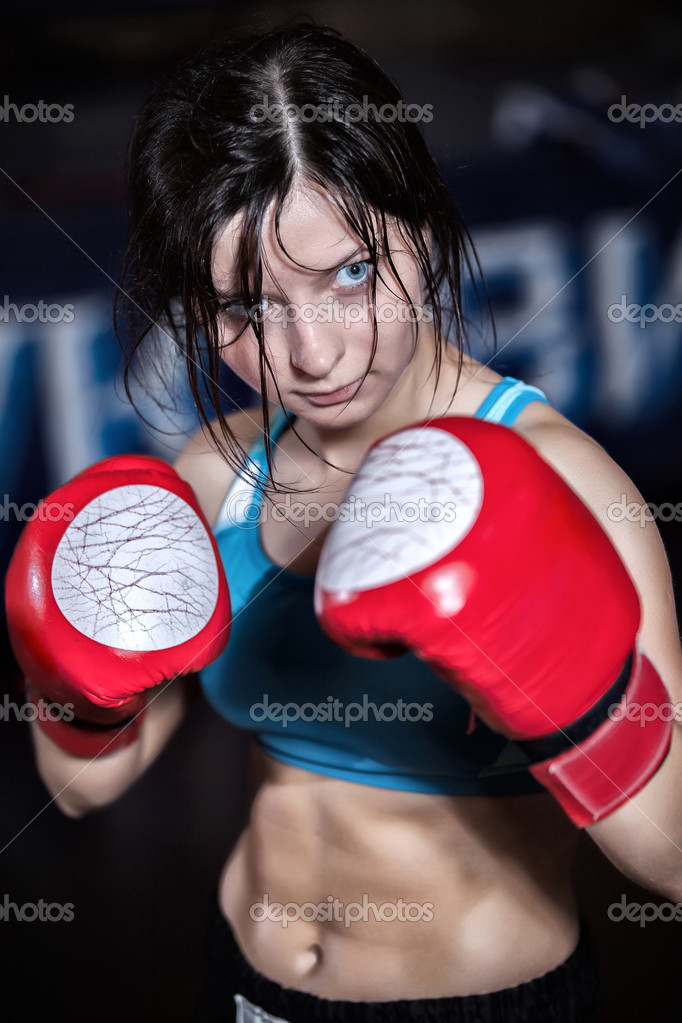Young and fit female fighter posing in combat poses — Stock Photo #13276229
