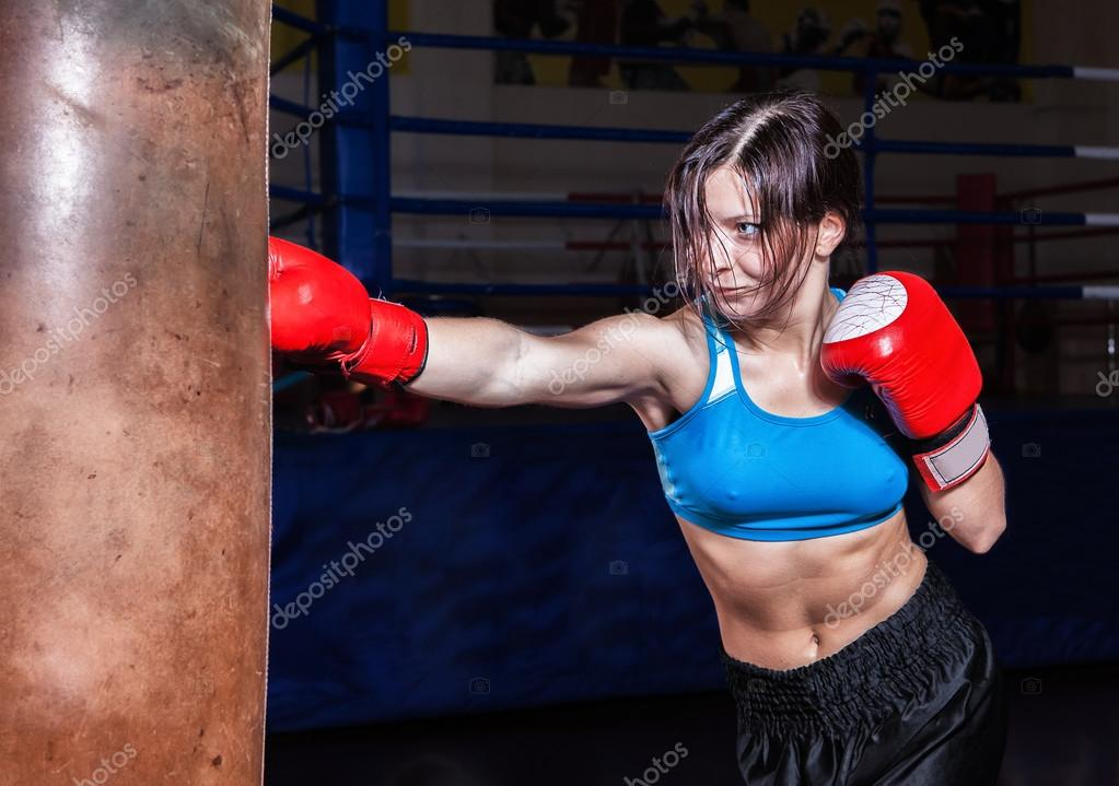 Young and fit female fighter posing in combat poses  Stock Photo #13276244