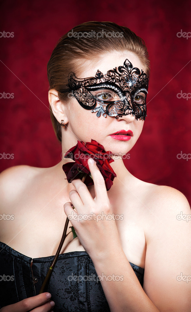 Portrait of beautiful woman in carnival mask with red rose  — Stock Photo #13276724