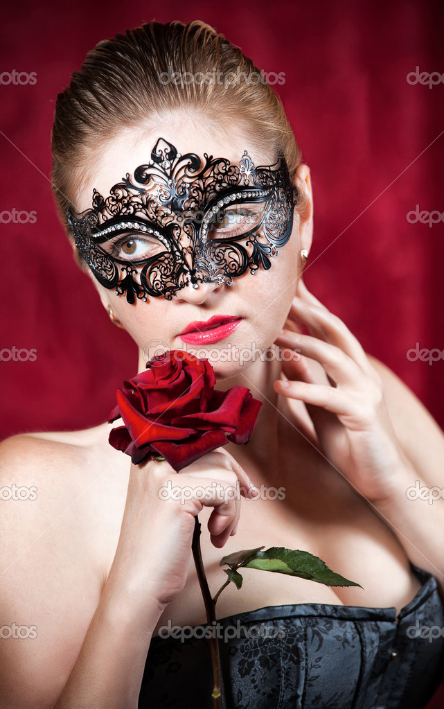 Portrait of beautiful woman in carnival mask with red rose   Stock Photo #13276759