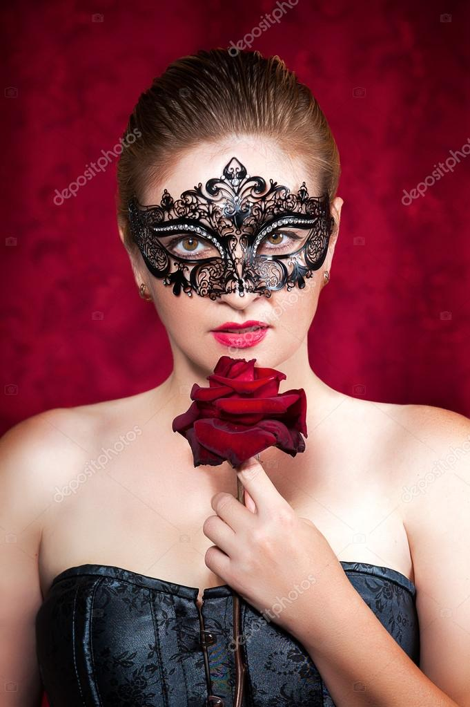 Portrait of beautiful woman in carnival mask with red rose  — Stock Photo #13276906