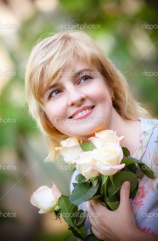 Happy smiling woman with flower  Stock Photo #13277059