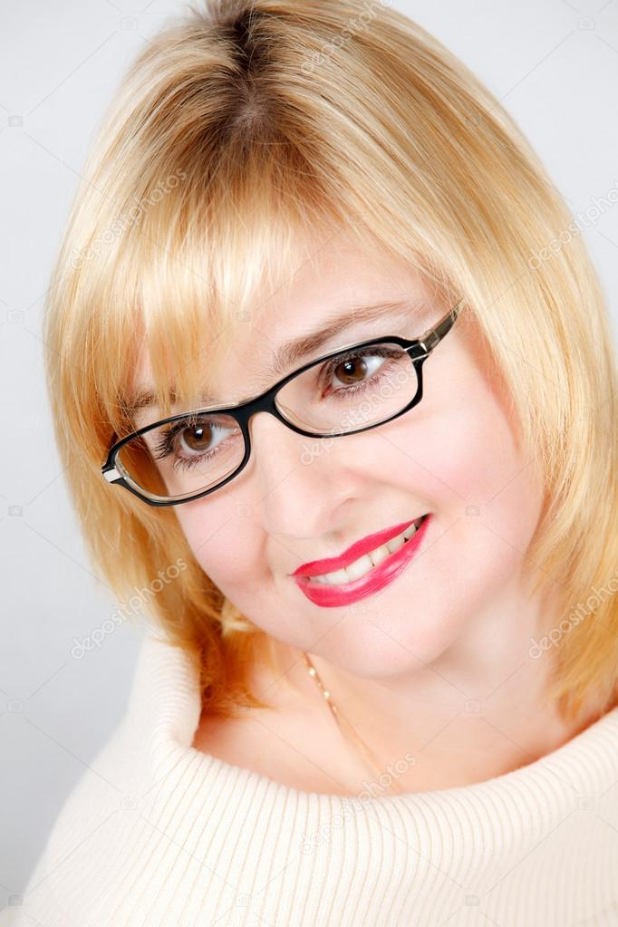 Portrait of lovely woman in glasses  Stock Photo #13277161