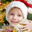 Small Santa Klaus with gifts — Stock Photo #1948067