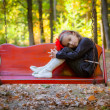 Portrait of the sad girl in park - Stock Photo