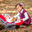 Little beautiful sisters in autumn park - Stockfoto