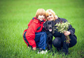 Happy family with Labrador — Stock Photo