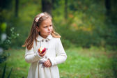 Girl  eating apple — Stock Photo