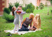 Happy family in garden — 图库照片