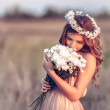 Girl in   camomile wreath — Stock Photo #47353375