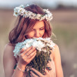 Girl in   camomile wreath — Stock Photo #47354239
