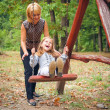 Mother and child in park — Stock Photo #47354581