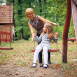 Mother and child in park — Stock Photo #47354633