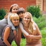 Happy family in garden — Stock Photo #47354637