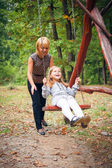 Mother and child in park — Stock Photo