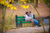 Couple in  autumn — Stock Photo
