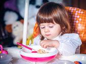 Eating baby girl — 图库照片