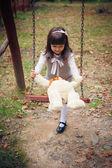 Girl and amusing bear — Stock Photo