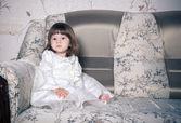 Baby girl   in white dress — Stock Photo