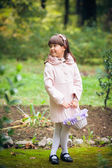 Liitle girl  in park — Stock Photo