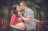 Pregnant woman eating apple — Stock Photo