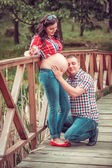 Man hug  pregnant wife belly — Stock Photo