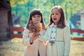 Happy little girlfriends in park — Stock Photo