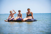 Family  on air bed on sea — Stock Photo