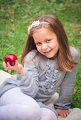 Girl is eating apple — Stock Photo