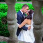 Newlywed couple kissing on  balcony — Stock Photo #48621437