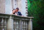 Newlywed couple  on  balcony — Stock Photo