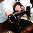 The sleeping young seamstress after wearisome work — Stock Photo #6685613