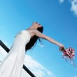Bride with a wedding bouquet — Stock Photo #9501190