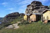 Tourist houses among rocks — Stock Photo