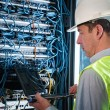 Electrician checking a fuse box — Stock Photo #37179923