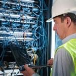 Electrician checking a fuse box — Stock Photo #37179923