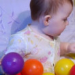 Baby playing with plastic balls — Stock Video #12431869