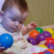 Stock Video: Baby playing with plastic balls