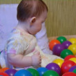 Baby playing with plastic balls — Stock Video #12431912