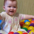 Baby playing with plastic balls — Stock Video #12431919