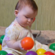 Baby playing with plastic balls — Stock Video #12431926