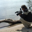 Cameraman on the bank — Stock Video
