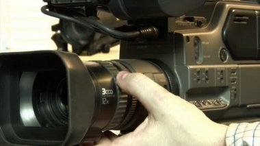 Dv-cam camcorder adjusting — Stock Video