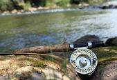 Flyfishing on mountain river — Stock Photo