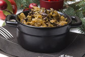Traditional polish sauerkraut (bigos) with mushrooms and plums — Stock Photo